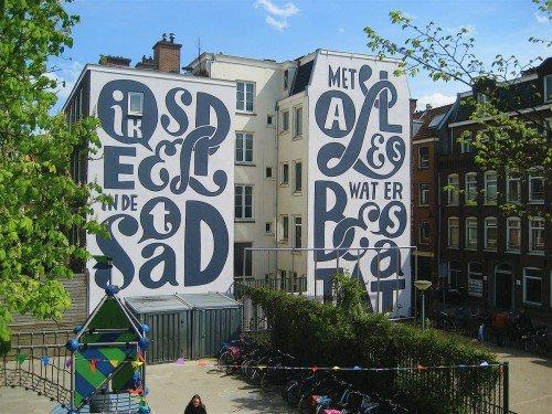 artwork, muurschildering groot op gebouw in Amsterdam, gemaakt door Piet Parra, Iwaarden artwork hielp mee om het mogelijk te maken