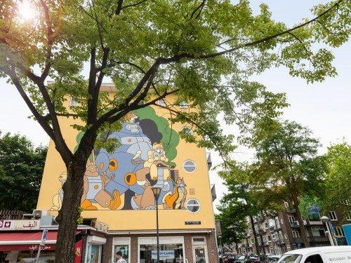 Muurschildering illustrator Stefan Glerum op gevel vrolijkt Bos en Lommer Amsterdam op met Reinaert de Vos