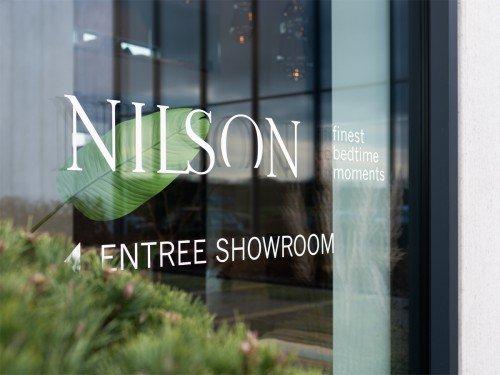Projectbeeld Nilson, bewegwijzering, gevelstyling door Iwaarden, Signing wayfinding