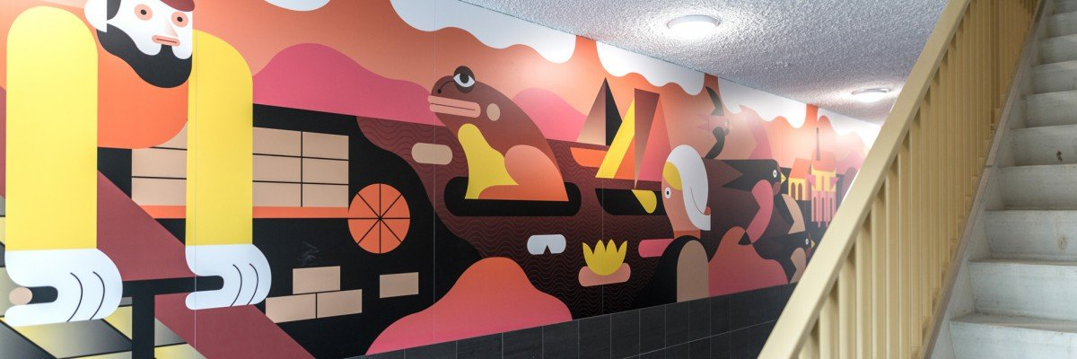 Artwork by illustrator Levi Jacobs executed as a mural in xl printing on the walls of an apartment building