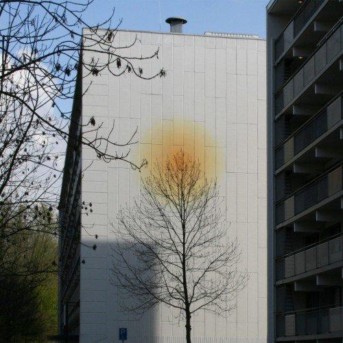 Kunstwerken geïnspireerd op interieur bewoners uitgevoerd door Iwaarden als muurschildering op flats Graan voor Visch Hoofddorp